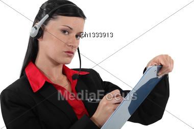 Serious Businesswoman Taking Notes Stock Photo