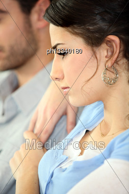 Serious Couple Watching TV Stock Photo