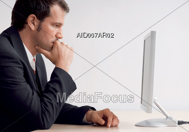 Serious Man at Computer Stock Photo