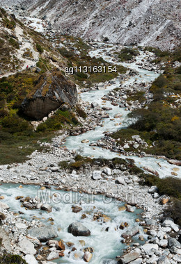 Serpentine Stream And Rocks In Himalayas. Captured In Sagarmatha National Park Stock Photo