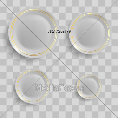 Set Of Ceramic Plates Isolated On Grey Checkered Background. Top View Stock Photo