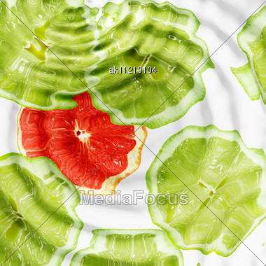 Set Of Cross A Citrus Fruits Under Water. Abstract Background. Close-up. Studio Photography Stock Photo