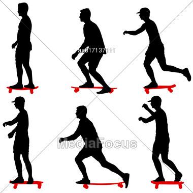 Set Ilhouettes A Skateboarder Performs Jumpingon A White Background Stock Photo
