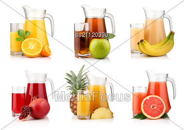 Set Of Jugs And Glasses With Tropical Fruit Juices Stock Photo