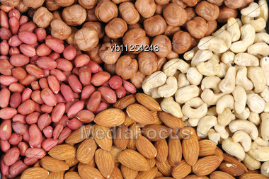 Set Of Nuts - Peanuts, Cashews, Almonds, Walnuts Stock Photo