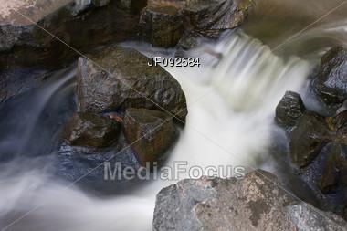 A Set Of Rapids Along A Small Creek Stock Photo