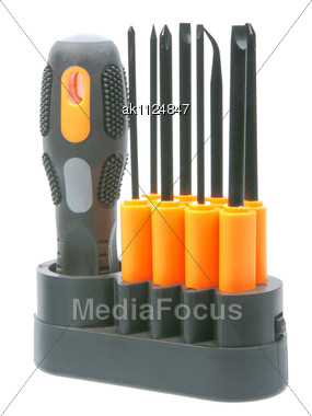 Set Of Orange-black Screwdrivers With Bits New Condition Close-up Studio Photography Stock Photo