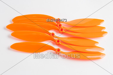 Set Of Orange Colored Propellers For RC Plane Model Stock Photo