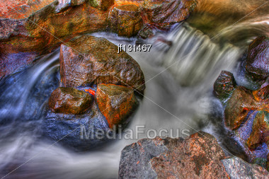 Set Of Rapids Along A Small Creek In High Dynamic Range Stock Photo