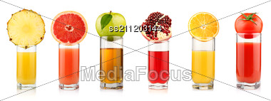 Set Of Tropical Fruit Juices In Glasses Stock Photo