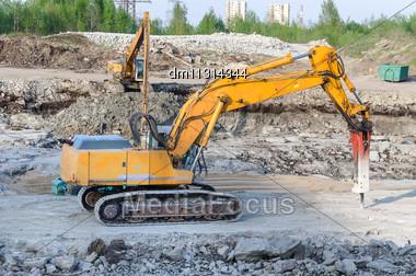 Several Excavators On Construction Site Stock Photo
