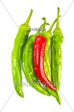 Several Green And One Red Capsicums Stock Photo