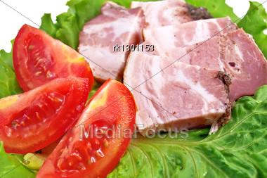 Several Pieces Of Bacon, Three Slices Of Tomato On Lettuce Leaf Isolated Stock Photo