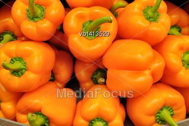 Several Pods Of Orange Sweet Pepper, Capsicum Stock Photo
