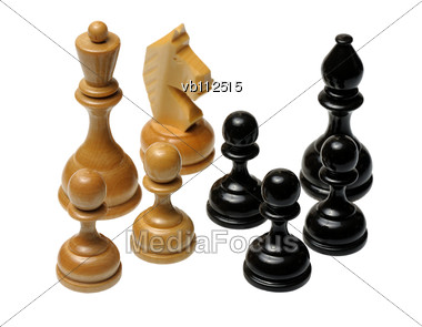 Several Wooden Chess Pieces Light And Dark Colors Stock Photo