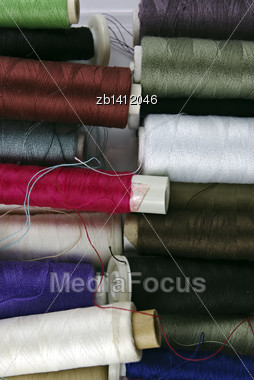 Sewing Cotton In Different Colors, Packed And Unpacked, In Plastic Box Stock Photo