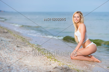 Sexy Blond Woman In Lingerie Posing On The Beach Stock Photo