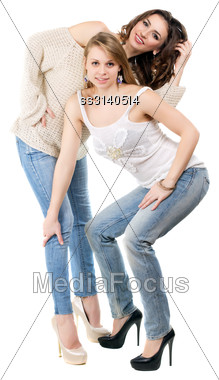 Sexy Blonde And Brunette Posing In Casual Clothing. Isolated On White Stock Photo
