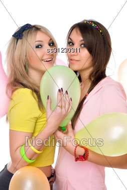 Sexy Brunette And Blonde Holding A Balloon Stock Photo