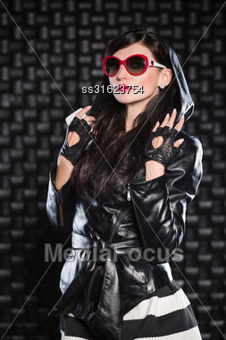 Sexy Brunette In Leather Jacket With A Hood Stock Photo