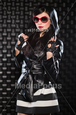 Sexy Brunette Wearing Leather Jacket With A Hood And Red Sunglasses Stock Photo