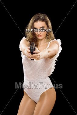 Sexy Girl In Bodysuit Aiming With A Gun Stock Photo