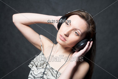 Sexy Woman With Headphones Listening To Music Stock Photo