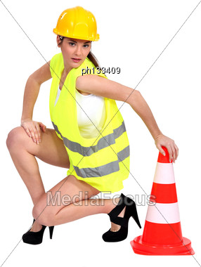 Sexy Woman Holding A Traffic Cone Stock Photo