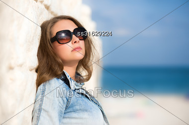Sexy Woman In Sunglasses Posing On The Beach Stock Photo