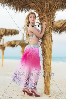 Sexy Young Blond Woman Wearing Pink Dress Posing On The Beach Stock Photo