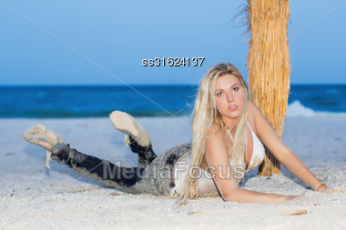 Sexy Young Blonde Lying On The Sand Stock Photo