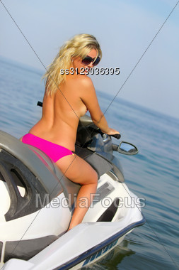 Sexy Young Blonde On A Jet Ski Stock Photo