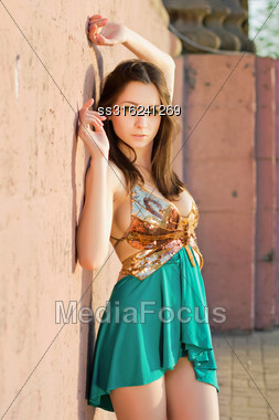 Sexy Young Brunette In Golden And Turquoise Dress Stock Photo