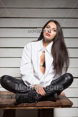 Sexy Young Brunette Posing In Fashionable Clothes Stock Photo