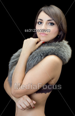 Sexy Young Brunette Posing In Fur. Stock Photo