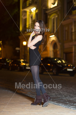 Sexy Young Brunette Wearing Black Dress Posing Near The Road Stock Photo