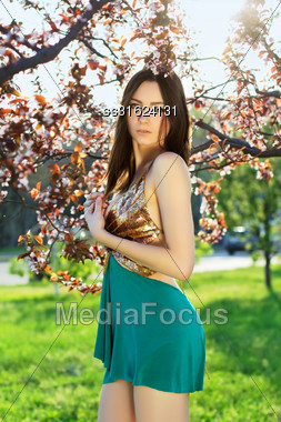 Sexy Young Lady Wearing Frank Dress Posing In The Garden Stock Photo