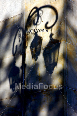 Shadow Of A Street Lamp And A Yellow Orange Marble Wall In La Boca Buenos Aires Argentina Stock Photo