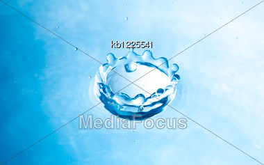 Shape Of Drop Of Water Splash Blue Color Stock Photo