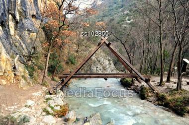 """A"" shaped wooden bridge over mountain creek Stock Photo"