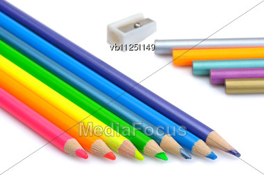 Sharpen And Unsharpen Colored Pencils And Pencil Sharpener Stock Photo