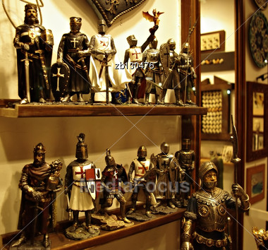 Shelf In Antiquities Shop With Metal Medieval Crusades Knight Soldiers. Stock Photo