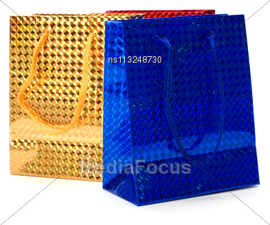 Shiny Paper Gift Bags Isolated On White Background Stock Photo