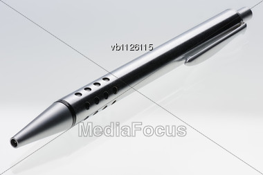 Shiny Steel Ball-point Pen And Its Reflection In The Glass Surface, Hyper DoF Stock Photo