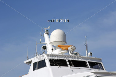 Ships Antenna And Navigation System In A Clear Blue Sky Stock Photo