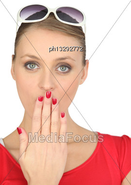 Shocked Blond Woman Covering Her Mouth Stock Photo
