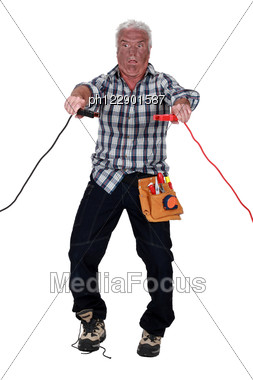 Shocked Electrician. Stock Photo