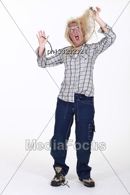 Shocked Female Electrician Stock Photo