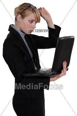 Shocked Woman Holding Laptop Stock Photo