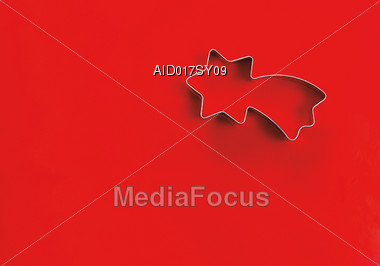 Shooting Star Cookie Cutter Over Red Background Stock Photo